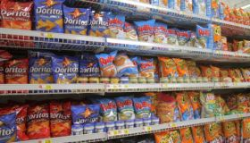 Shelves of potato chips for sale at Walmart.