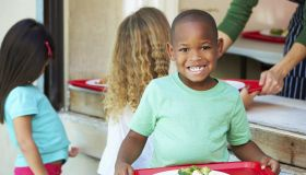 Elementary Pupils Collecting Healthy Lunch In Cafeteria
