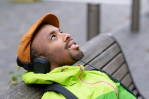 Man sitting outside, listening to music