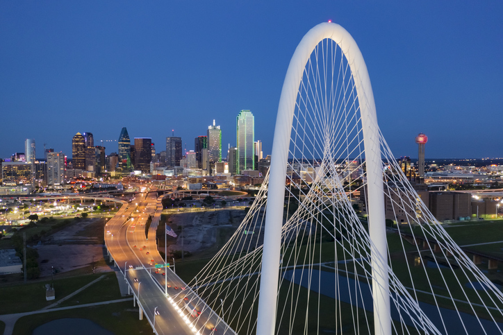 Elevated View of the Margaret Hunt Bridge and the Dallas Skyline at Dusk